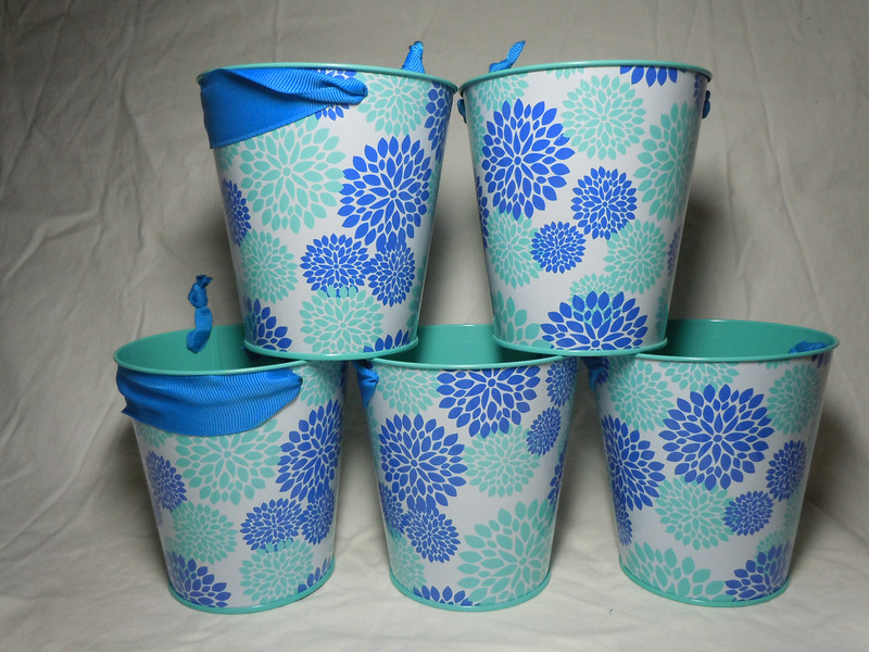 Blue Floral Metal Buckets with Blue grosgrain ribbon handle.  They are about 4 inches in height, 4 inches on the opening, and 2 7/8 inches on the bottom.  5 available.  $1 each or all 5 for $4