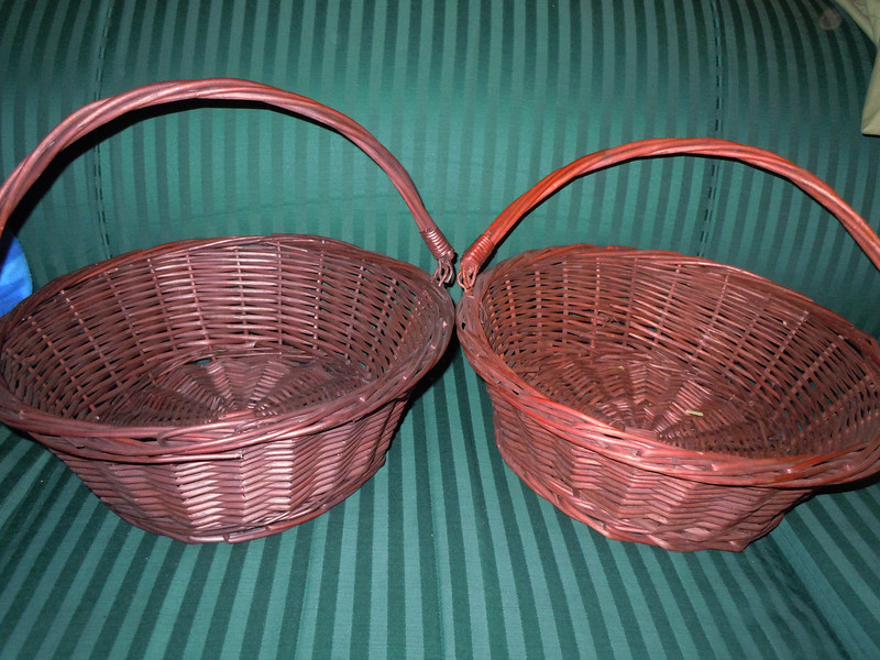 """2 Dark chocolate brown wooden baskets with movable handle.  $4 each.<br /> Base is 10"""" wide, Top is 13"""" wide, 5"""" tall without the handle. 12"""" tall with handle."""