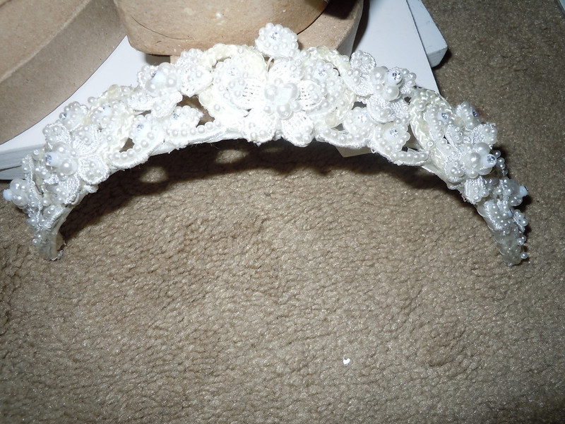 another shot<br /> <br /> Headband included in a wedding dress I originally bought for my wedding.  It's pearlized with some floral.<br /> <br /> $1