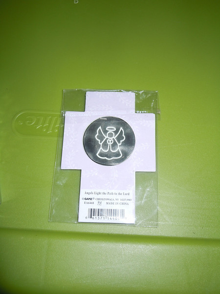 View of the back of the coin and the packaging<br /> <br /> Angel coin (six pence coin), $2