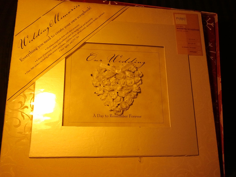 White Wedding scrapbook with a shadowbox window on the front with a 3D paper flower heart on the front. New, One available, $10