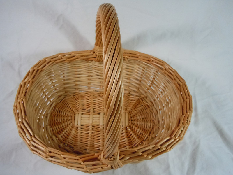 """Wooden basket.  Handle does not move.  Bottom is 9"""" length and 6 1/2"""" the across.  The opening is 10"""" length and about 7 1/2"""" across.  Height with handle is about 9"""".  One available, $3"""