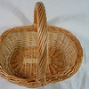 "Wooden basket.  Handle does not move.  Bottom is 9"" length and 6 1/2"" the across.  The opening is 10"" length and about 7 1/2"" across.  Height with handle is about 9"".  One available, $3"