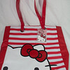 "large hello kitty Red and white tote bag NEW WITH TAGS. The front side is red and white striped with hello kitty face peaking out of the corner. The rest of the bag is red. Backside has white cloud with hello kitty within it. The straps are red vinyl. The inside is made up of hello kitty black material. Front inside has two small pocket, back inside has a zippered pocket. Back side of purse has a large pocket. 14"" across, 15"" in height, and about 4"" in width. Retails for $49.95. I'm selling for $25"