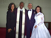 Wedding Pastor and Wife with New Couple
