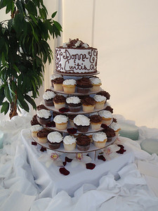 Wedding cake and tiers of cupcakes