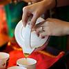 Pouring tea.