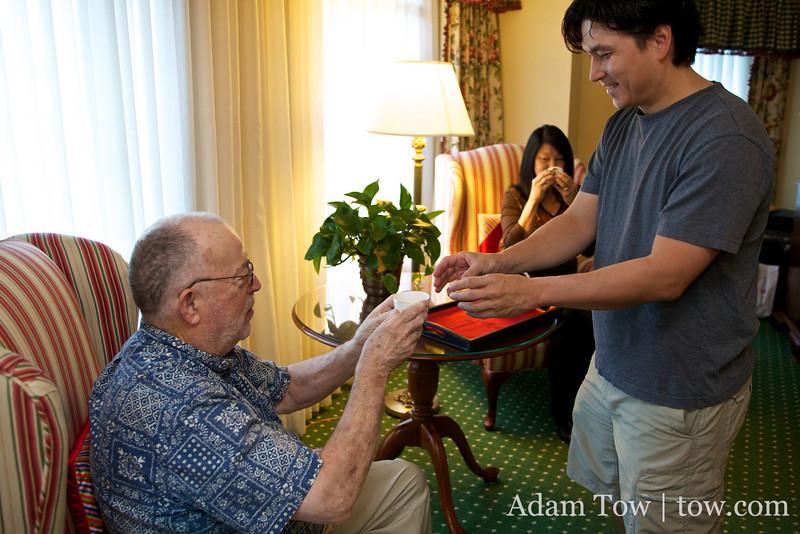 Kekoa gives tea to his father.