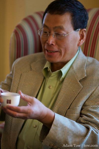Uncle Pluto takes his tea.