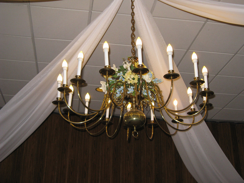 Dance Canopy- We used the existing chandelier as the center of the dance canopy.  We put some blue and yellow flowers on the chandelier to coordinate with the wedding colors.  <br /> A Villa Louisa in Bolton