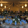 Winter Wonderland-White and Blue Tulle with hanging Snowflakes in the columns.  The tablecovers are white underlays with shiny silver lame overlays. <br /> Maneeley's in South Windsor
