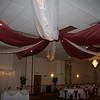Burgundy and White Canopy- White tulle with burgundy fabric and lights.  This canopy is very full and works for a large room, but it is a lot more work and costs more than my regular dance canopy with columns because of the number of times I have to go up and down a 14' ladder to attach the fabric and lights to the ceiling. <br /> Maneeley's in South Windsor
