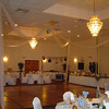 Blue Cinderella Wedding- Tulle Dance Canopy with a Blue Hydrangea Kissing Ball in the Center.  The tablecovers and chairs are basic white with silver organza sashes. <br /> Maneeley's in South Windsor