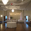 Tulle Dance Canopy-  This canopy is all white tulle with no columns.  The kissing ball is pink gerbera daisies.  Bows are tied at each corner and the tulle goes right to the ground to keep it from blowing around when the air conditioning is on.<br /> Maneeley's in South Windsor