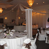 Asian Themed Wedding- Dance Canopy with simple white lanterns hanging from the ceiling.  The tablecovers and chairs are basic cream with brown organza sashes. <br /> Maneeley's in South Windsor