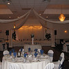 Blue and Cream Wedding- This wedding included a lighted dance canopy and a tulle decorated head table.  The social hour table is in the middle of the dance floor, and is moved before the introductions and dancing begin.  The tablecovers and chairs are basic cream with navy organza sashes. <br /> Maneeley's in South Windsor