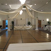 Calla Lilly Wedding-Dance Canopy with Calla Lillies on each column and a Calla Lilly Topiary Ball.  The tablecovers and chairs are basic cream with silver silk sashes. <br /> Maneeley's in South Windsor