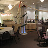 Venetian Themed Prom- Dance Canopy with greenery and Red Roses on each column with a red and gold swag in the center.<br /> Maneeley's in South Windsor