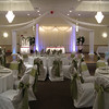 Watermelon Pink and Honeydew Melon Green Wedding-  Dance Canopy in White fabric with a pink Gerbera daisy kissing ball.  The Sweetheart table, cake table, and gift table were lighted with a band of matching pink ribbon around the top.  The chair covers are white with Honeydew Green sashes.  <br /> Maneeley's in South Windsor