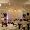 Snowflake Wedding-Dance Canopy with Snowflakes in each column and Snowflakes suspended from the ceiling.  The tablecovers and chairs are basic cream with brown silk sashes. <br /> Maneeley's in South Windsor