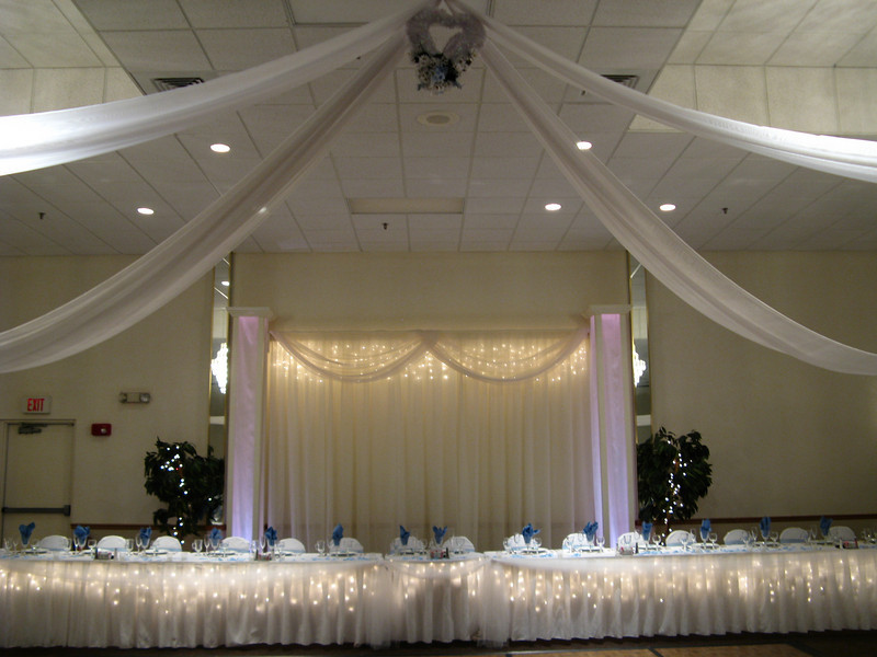 Blue and White Wedding- The center of the dance canopy is three hearts decorated with the bride's flowers.  We used white daisies and blue delphinium to match her centerpieces. <br /> The hearts were a gift from her mother.  The bride wasn't sure what to do with them, so I incorporated them into the canopy.<br /> Maneeley's in South Windsor