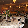 Dance Canopy- This is a shot of the room with the dance canopy and head table in a central location.  Tables are on either side of the dance canopy. Fall colors, chocolate brown and orange. The tablecovers and chairs are basic cream with brown silk sashes and cream patterned overlays. <br /> Maneeley's in South Windsor