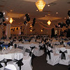 Silver and Black Prom-Dance Canopy with Balloon Center. I also did the balloon centerpieces and the New York Backdrop behind the DJ. The tablecovers and chairs are basic white with black organza sashes. <br /> Maneeley's in South Windsor