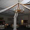 Fall Dance Canopy- Ivory Dance Canopy with chocolate brown ribbon accent.  The flowers in the chandelier matched the centerpieces.  Notice the lighted and decorated fireplace in the background.<br /> A Villa Louisa in Bolton