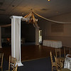 Fall Dance Canopy- Ivory dance canopy with chocolate brown ribbon in the swags.  Fall flowers to match the centerpieces were used in the chandelier to add color. <br /> A Villa Louisa in Bolton
