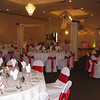 Red and White Wedding- Dance Canopy with Red Roses on each column and a Red Rose Topiary Ball in the center.  The tablecovers and chairs are basic white with red silk sashes. <br /> Maneeley's in South Windsor