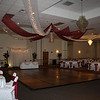 Burgundy and White Dance Canopy- The canopy looked beautiful over the large dance floor.  The white fabric is tulle with lights and the burgundy is a silky curtain material that draped beautifully.  The kissing ball in the center had burgundy hydrangeas and white calla lillies.  The bride had black magic roses and calla lillies in her centerpieces with white linens and burgundy silk sashes. <br /> Maneeley's in South Windsor