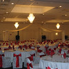 Red & White Wedding- This picture was taken before the floral centerpieces arrived. The canopy is simple with no flowers on the columns or center decoration. The tablecovers and chairs are basic white with red silk sashes. <br /> Maneeley's in South Windsor