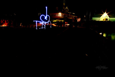 I heart Tim  Light Art during the Bonfire Reception at Club Manitou at the Homestead Resort in Glen Arbor, Michigan.  Tim and Darby tributes with light and long exposures.  © Copyright m2 Photography - Michael J. Mikkelson 2009. All Rights Reserved. Images can not be used without permission.