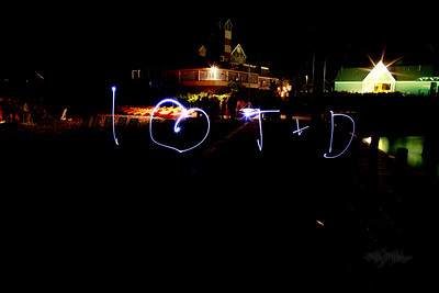 I love  T + D  Light Art during the Bonfire Reception at Club Manitou at the Homestead Resort in Glen Arbor, Michigan.  Tim and Darby tributes with light and long exposures.  © Copyright m2 Photography - Michael J. Mikkelson 2009. All Rights Reserved. Images can not be used without permission.