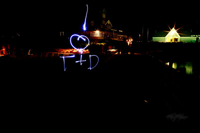 I heart  T + D  Light Art during the Bonfire Reception at Club Manitou at the Homestead Resort in Glen Arbor, Michigan.  Tim and Darby tributes with light and long exposures.  © Copyright m2 Photography - Michael J. Mikkelson 2009. All Rights Reserved. Images can not be used without permission.
