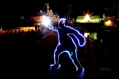 Posing Guy?!?  Light Art during the Bonfire Reception at Club Manitou at the Homestead Resort in Glen Arbor, Michigan.  Tim and Darby tributes with light and long exposures.  © Copyright m2 Photography - Michael J. Mikkelson 2009. All Rights Reserved. Images can not be used without permission.