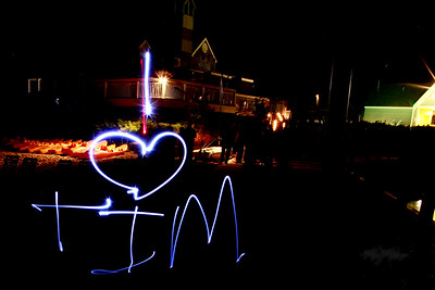 I love  Tim  Light Art during the Bonfire Reception at Club Manitou at the Homestead Resort in Glen Arbor, Michigan.  Tim and Darby tributes with light and long exposures.  © Copyright m2 Photography - Michael J. Mikkelson 2009. All Rights Reserved. Images can not be used without permission.