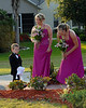 The bridesmaids help the ring bearer move along.