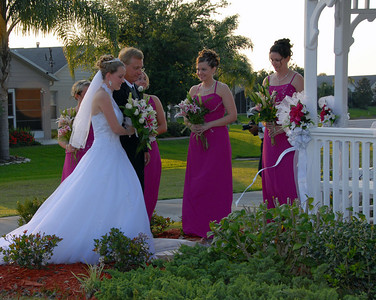 Kim passes by her bridesmaids.