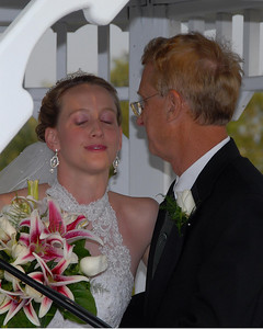 Kim prepares to kiss her father on the cheek.  If I could have waiting one more second I would have gotten a much better photo.