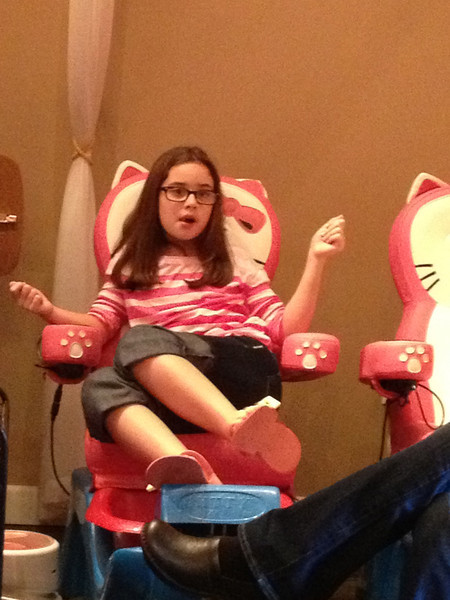 Scout getting her nails done, and telling a story.