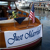 After deck of the Lorelei. Just married sign by Lake Geneva Cruise Line. Photography by Michael Schlicting