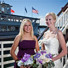 Bride and Bride's maid on bow of Duchess.  Floral by Peche's, Bride & Bride's maid wedding dress by Christy's Bridal, Photography by Matt Mason Photography.