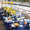Sit down dinner on the upper deck of the Louise.  Floral by Frontier Flowers, Linens by Carousel Linens, Glassware and Votives by Cornerstone, placecards by Creative Element, and Photography by Matt Mason Photography.