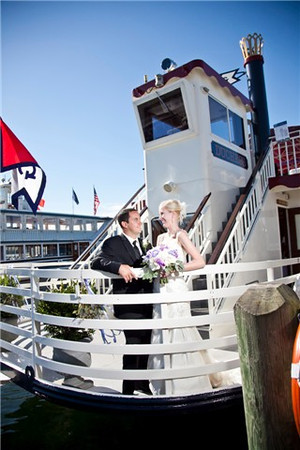 Wedding Couple on the bow of the Duchess.  Photography by Matt Mason Photography.
