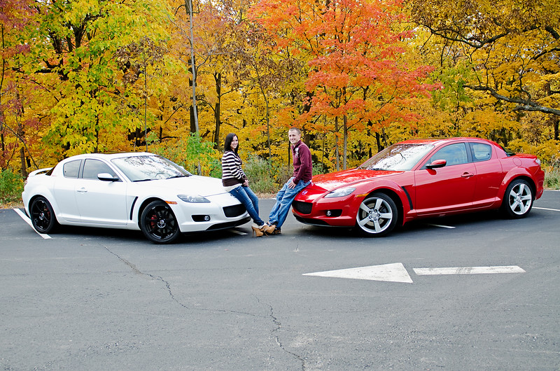 Engagement photo near a park by Holy Hill. The couple has his and her Mazdas.