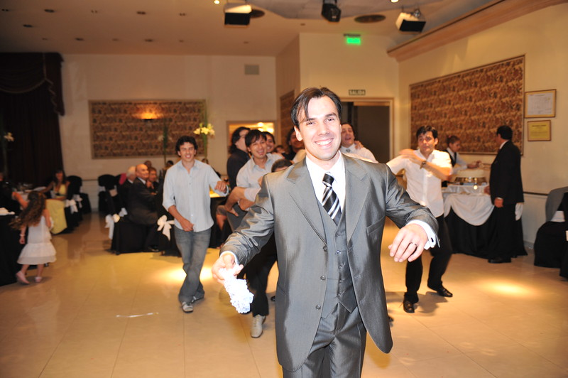 Patricio is getting ready to throw the garter to his friends...