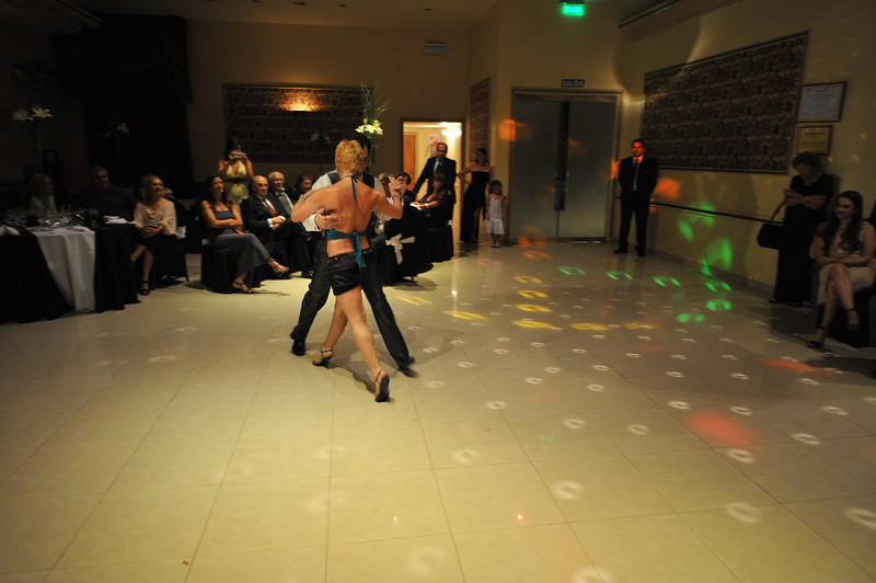 Patricio was dancing tango with couple of our friends after trying with me but beeing imposible to do, due to the design of my dress.<br /> ~Eva~