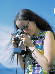 Our friends took pictures and shared them with is. (This is Marriott with her beloved Minolta.) They saw us at different angles, through different lenses, and the pictures have faded in various idiosyncratic ways over the last 40 years. That's how memory is.