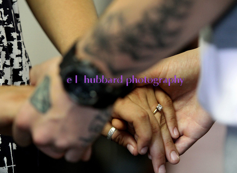 E.L. Hubbard photography<br /> Kari Gregory and Nathan Carberry hold hands after exchanging rings as they are wed by New Life Ministries pastor Gary Barrett Tuesday, Aug. 16, 2011.